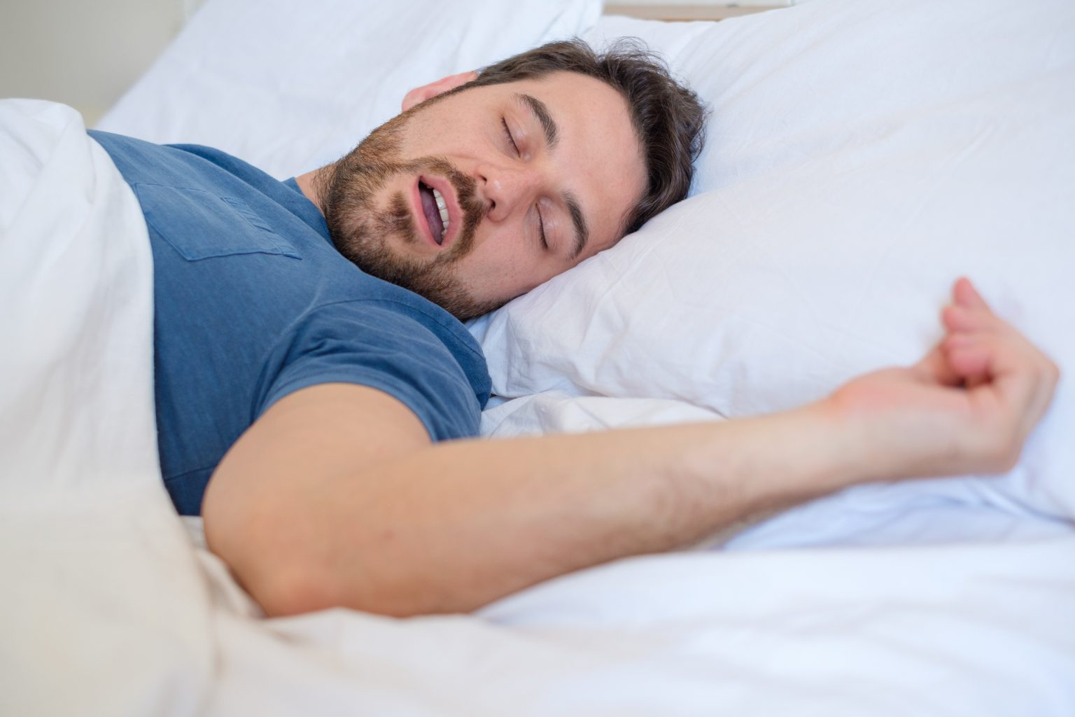 snore problem concept.man in bed snoring and sleeping